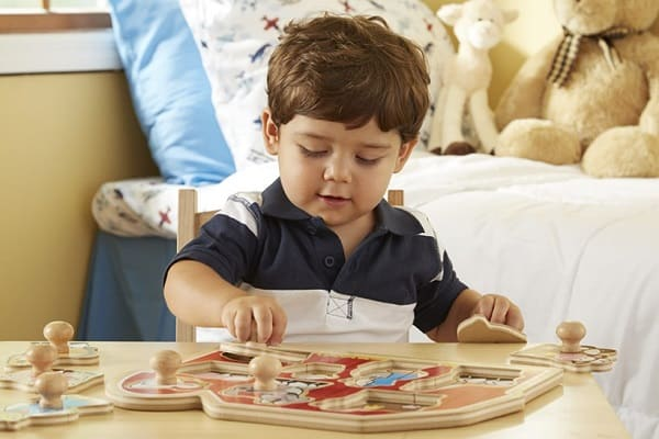 Best Toys for 1-Year-Old, the lot dallas, boy-playing-Melissa-Doug-Knob-Puzzle
